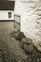 M046 (Gerry Mulligan Photography) Tags: ireland sepia baskets cobbles nireland blackandwhitephotography blackandwhitephoto sigma18200 ulsterfolkandtransportmuseum nikond5100
