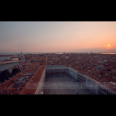The sun illuminates only the eye of the man, but shines into the eye and the heart of the child (** Nico **) Tags: venice sunset sea italy panorama sun skyline square boat cityscape view gap gettyimages stmarksquare nicodepasquale gettyimagesitaly stmarktower gettyimagesitalyq2 gettyimagesitalyq3