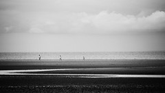 Th_____re______e (Andrew Lockie) Tags: uk england people bw beach monochrome coast mood tide norfolk atmosphere isolation tidal hunstanton 16x9 expanse oldhunstanton thewash