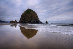 Cannon Beach (Brandon Godfrey) Tags: ocean summer usa seascape reflection water clouds oregon reflections landscape photography sand waves cloudy or unitedstatesofamerica wave overcast pacificocean needle pacificnorthwest oregoncoast ripples cannonbeach haystackrock westcoast iconic hdr glassy seastacks 2011 clatsopcounty tonemapped touristdestination