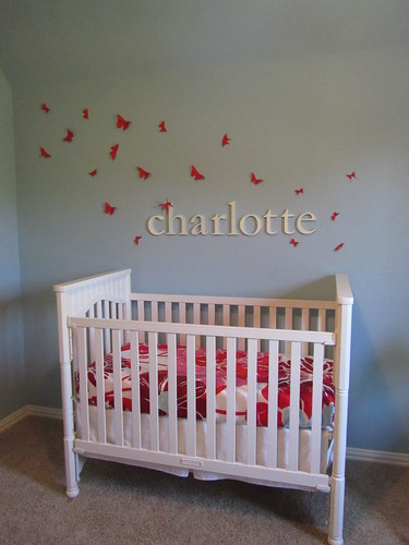 Butterflies, letters and crib.