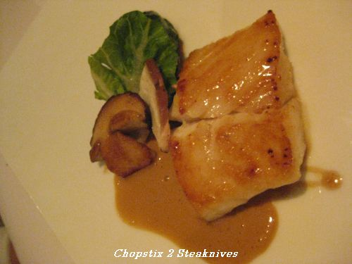 Fillet of turbot with braised baby gem lettuce, leeks and cep sauce