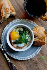 Baked Egg with Sauteed Spinach, Goat Cheese and Proscuitto (Jonathan Gayman | Photographer) Tags: coffee breakfast baking brunch goatcheese spinach cherrytomatoes proscuitto foodphotography bakedeggs ramekins