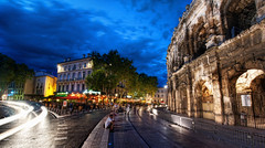 Exploring Nimes (Stuck in Customs) Tags: world road street city travel people blur france rome history cars caf architecture night digital speed french photography evening blog high twilight ancient europe republic traffic dynamic state roman dusk south events crowd amphitheatre july arena southern photoblog software processing western historical intersection imaging nightlife amphitheater nimes region range roussillon department hdr languedoc tutorial trey gard nmes southernfrance gaul rpubliquefranaise bullfights 2011 ratcliff viadomitia hdrtutorial stuckincustoms treyratcliff photographyblog stuckincustomscom colonianemausus llenguadocrossell lengadcrosselhon