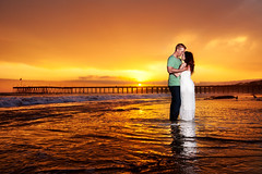 Love on Fire (Extra Medium) Tags: sunset orange love pier engagement kiss dress ventura strobist santabarbaraweddingphotographer megannick pt04cn camarilloweddingphotographer venturaweddingphotographer beachweddingphotographer ishootpt04triggers