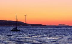 A boat at sunset (MrAchab) Tags: sunset sea boat barca tramonto mare niceshot pylon scilla calabria pilone mygearandme