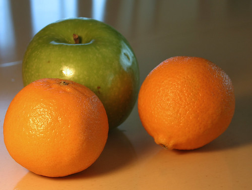 Two oranges, one apple