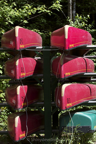 Stacks of canoes ready to be pulled off the rack