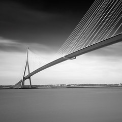 Le pont de Normandie (Front page) (Coco Carrigan) Tags: bridge bw seine canon river pose long exposure sigma nb pont normandie honfleur 1020 normandy calvados fleuve longue 400d