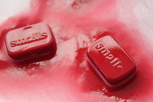 spray painting altoid cans with red spray paint