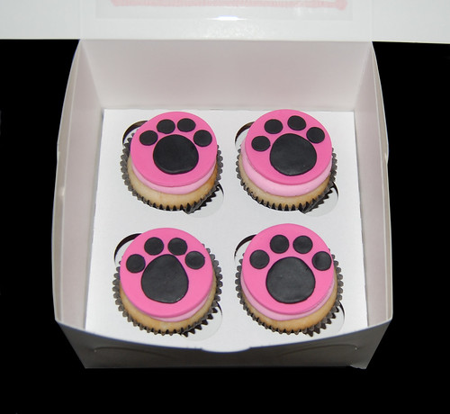 pink and black paw print cupcakes