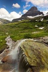 Falling into Reynolds Mt. (thephantomhennes) Tags: park mountain water pass falls glacier national hennes logan reynolds yahoo:yourpictures=landscape