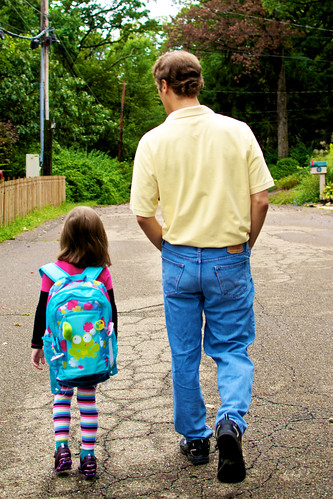 Walking to the bus stop with Daddy.
