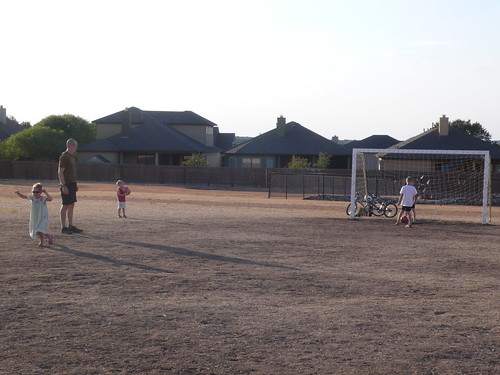 Playing soccer at the field behind our school