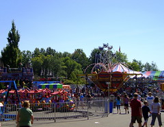 A & P Midway. (dccradio) Tags: panacea pacelli stevenspoint carnival festival fundraiser catholicschoolsfundraiser communityevent fair ap apenterprises apshows apcarnival carnivalride ride mechanicalride mechanicaldevice amusements amusementride fairride fence ridefence train trainride familytrain childrenstrain sky bluesky tree trees greenery dragonwagon wisdom wisdomindustries wisdommanufacturing wisdomrides coaster portablecoaster rollercoaster dragon speedway zamperlarides zamperlamanufacturing zamperlaindustries racingride nascar carride tornado thrillride eliwheel ferriswheel hy5ii orangewheel wheel elibridgecompany eli12 elibridge elimanufacturing scooter bumpercars majestic majesticrides majesticmanufacturing majesticindustries merrygoround carousel jenny horse horses mgr