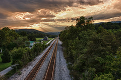 Railroad Tracks Glowing in the Sunset  [EXPLORED] (curtisWarwick) Tags: railroad sky clouds rural virginia countryside farm country norfolk tracks southern overlook hdr sunet
