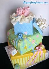 Baby Shower Stacked Gift Boxes Cake (Elegant Cake Creations AZ) Tags: pink blue arizona green phoenix yellow square stripes explore bow quilting elegant babyshower lid polkadot babyblocks babybooties tissuepaper fondant 3tier customcake stackedpackagecake