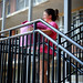 Amber Perk takes a break on the stairs of Bragaw Hall during move-in.