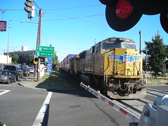 Two locomotives push the train away from us