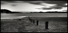 Icy Sea (rodvelt) Tags: ocean longexposure winter sea sky bw white black ice water grass silhouette norway canon geotagged norge skies symmetry icy 1022mm hdr kristiansand 3xp 50d hamresanden hoyandx400