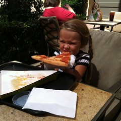 Pizza as big as her head.