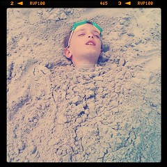 Eli sleeping in sand