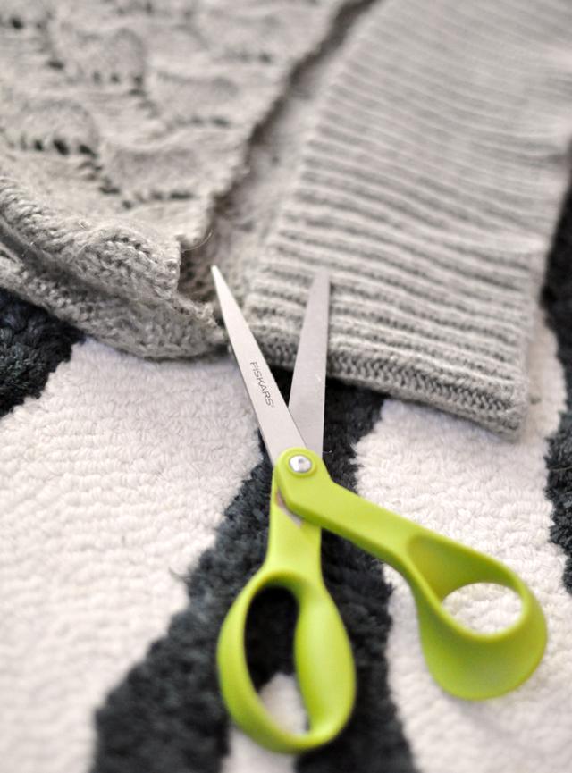 cutting a sweater
