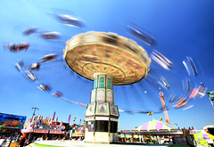 Going for a Spin at the State Fair (` Toshio ') Tags: carnival people kids canon fun person moving high colorful glow ride state legs action swings flight vivid maryland wave fair baltimore 7d swinging timonium toshio marylandstatefair wellenflieger fahrgeschft wellenflug