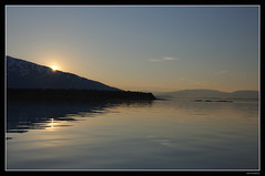 Arctic sunlight (Chris_AJ) Tags: blue light sun silhouette calm arctic valnesfjord