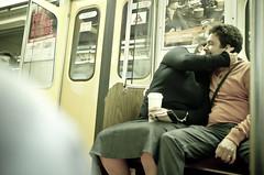 Psst. I've got a secret... (Daifuku Sensei) Tags: toronto subway kissing whisper fuji candid ttc secret passengers finepix x100 geotaqgged 4366641257115679402570724487