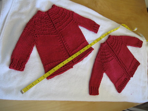 Of course each baby gets her own sweater (tape measure to give you a sense of size)
