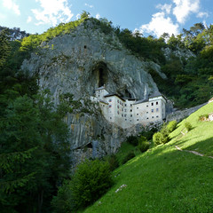 A medieval appearance of the Predjama Castle in Slovenia (Bn) Tags: castle history geotagged countryside high topf50 jackie rocks tunnel chapel dungeon flags medieval cliffs tournament slovenia chan cave grad visitor karst region topf100 fortress renaissance castel baron hideout robber 1420 postojna burcht grot predjama lueg 100faves 50faves hhlenburg predjamski erazem geo:lat=45815879 culturalandhistoricalheritage lueghi gradpredjama notranjskakarst 1000uploadsopdedoka geo:lon=14127055 predjama1 knightsofadelsberg