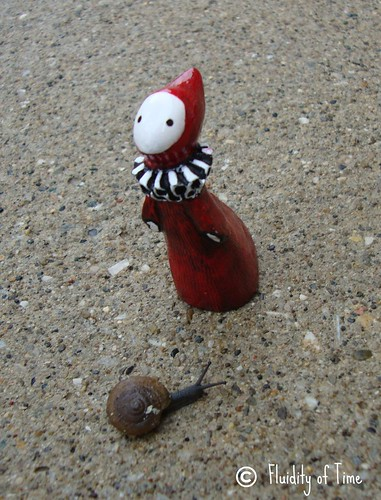 poppet with tiny snail