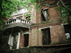 Taiwanese Haunted House III (weizor) Tags: trees windows green abandoned nature wet rain architecture lumix asia balcony taiwan panasonic doorway derelict chiayi vignette jiayi tw hauntedhouse overrun micro43 microfourthirds 20mmf17asph dmcg3