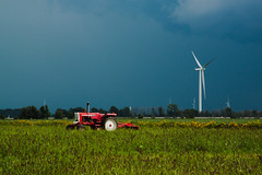 254/365 September 11 - Flat With Turbines (Sharon Drummond) Tags: autumn sky tractor ontario canada storm fall field weather clouds rural project landscape grey flat wind farm essexcounty 365 thunder turbine windturbines comber project365 chathamkent scavchal