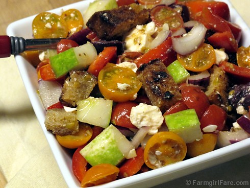 Greek Style Panzanella Salad with cherry tomatoes, kalamata olives, feta cheese, and homemade croutons 2 - FarmgirlFare.com