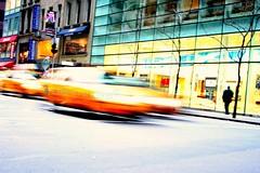 Taxi motion (lifeinapixel) Tags: street new york city nyc motion blur yellow speed strada traffic manhattan cab taxi giallo shops movimento velocit traffico vetrine