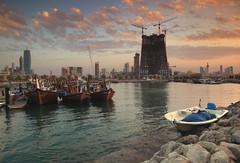 Kuwait - Fishing boats at sunset ( Saleh AlRashaid / www.Salehphotography.net) Tags: city sunset canon photo cityscape outdoor middleeast canon5d kuwait scape souq kuwaitcity q8 saleh sharq alkuwait   kuwaitdesert kowait citynightshot leefilters kuwaitphoto kuwaitphotos    alrashaid salehphotographynet  dawlatalkuwaytisasovereignarabnationsituatedinthenortheastofthearabianpeninsulainwesternasiaitisborderedbysaudiarabiatothesouthatkhafji andiraqtothenorthatbasraitliesonthenorthwesternshoreofthepersiangulfthenamekuwaitisderivedfromthearabicakwat thepluralofkout meaningfortressbuiltnearwater5theemiratecoversanareaof17 820squarekilometers6 880sqmiandhasapopulationofabout36million2historically theregionwasthesiteofcharacene amajorparthianportfortradebetweenindiaandmesopotamiathebaniutbahtribewerethefirstpermanentarabsettlersintheregionandlaidthefoundationofthemodernemiratebythe19thcentury kuwaitcameundertheinfluenceoftheottomanempire andafterworldwari itemergedasanindependentsheikhdomundertheprotectionofthebritishempirekuwaitslargeoilfieldswerediscoveredinthelate1930safterkuwaitgainedindependencefromtheunitedkingdomin1961 thenationsoilindustrysawunprecedentedeconomicgrowthin1990 middleeastmiddleeastgccgulfarabiankuwaitalkuwaitq8thestateofkuwaitikuwetarabic kuwaitsanddunes