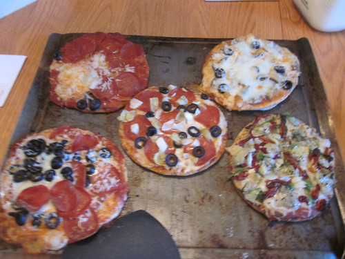 Five finished mini-pizzas