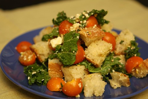 Honeyed Kale Salad with Feta, Sun Gold Tomatoes, Lemon, Bread, and Basil