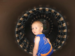 Logan crawls through a tunnel