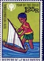 Maldives postage stamp boy with model sailboat (oldsailro) Tags: park old boy sea summer people sun lake playing beach water pool girl sunshine youth sailboat race vintage children fun toy boat miniature wooden pond model waves sailing ship child with time yacht antique group boom stamp mat regatta hull spectators maldives watercraft postage adolescence keel fashioned