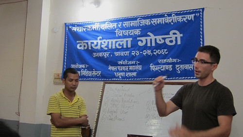 Presenting to Nepali journalists and editors on social media. Prakash Mohara is translating.