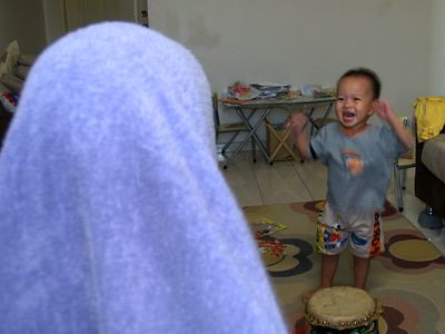 Boys playing tudung