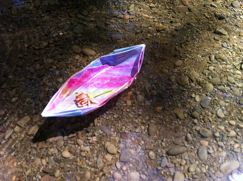 origami boat dipped in wax