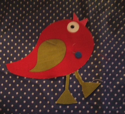 Bird motif pinned on