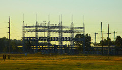 Power Station At Dusk (LostMyHeadache: Absolutely Free *) Tags: trees light shadow sky signs building field grass silhouette nikon glow zoom horizon structure powerlines wires powerstation davidsmith calgaryalbertacanada