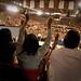 Audience members cheer the president.