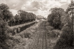 Steam on the Horizon (Monochrome) (bbusschots) Tags: ireland bw monochrome clouds train canal blackwhite rail steam maynooth hdr steamtrain topaz kildare royalcanal photomatix tonemapped tthdr rpsi no186 topazadjust topazbweffects