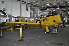 T-6 SNJ Texan (warriorwoman531) Tags: california museum sandiego military jets navy ussmidway fighterplanes snjtexan